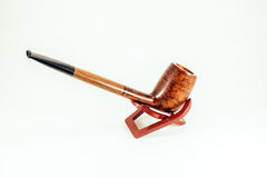 Elegant tobacco pipe Stock Images