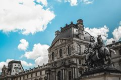 The elegant traditional architechture of the building and statue. Paris, France - 20 MAY, 2017: The elegant traditional architechture of the building and statue royalty free stock images