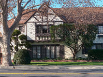 Elegant Tudor style Victorian house. Tudor style house with visible brown beams and other wooden decorations Stock Photos