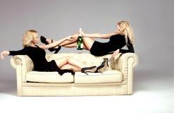 Elegant two woman celebrating. Royalty Free Stock Image