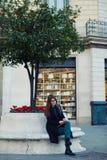 Elegant university student use digital tablet outdoors Royalty Free Stock Images