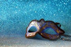 elegant venetian mask on blue glitter background Stock Photos