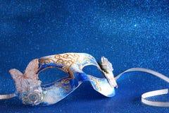 elegant venetian mask on blue glitter background Royalty Free Stock Image