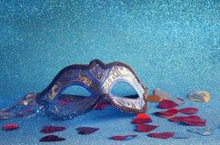 elegant venetian mask on blue glitter background Royalty Free Stock Photography
