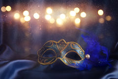 elegant venetian mask on blue silk background Stock Photos