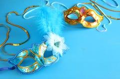 Elegant venetian mask on blue wooden background.  Stock Image