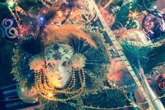Elegant Venetian Mask. Carnival mask with feathers on a background of holiday lights Royalty Free Stock Photo