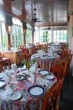 Elegant Victorian Brunch Dinning Porch. Elegant Victorian brunch dinning area, tables set on sun filled porch Stock Images