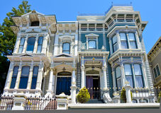 Victorian duplex in San Francisco. Elegant Victorian duplex in the Queen Anne style in San Francisco on a sunny day against a brilliant blue sky Royalty Free Stock Photography