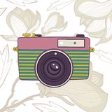 Elegant vintage camera on floral background Royalty Free Stock Image