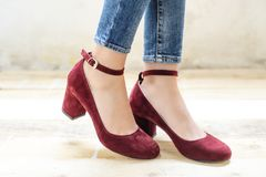 Elegant vintage female footwear. Vintage style shoes with heels worn on female legs with skinny jeans Stock Images