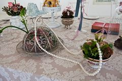 Elegant vintage pearls and flowers on a silk lace table cloth stock photography