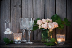 Elegant vintage wedding table decoration with roses and candles Stock Photography