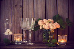 Elegant vintage wedding table decoration with roses and candles Stock Images