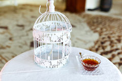 Elegant vintage white bird cage wedding decoration on small tabl Royalty Free Stock Photos