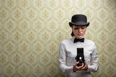 Elegant vintage woman photographer stock photos