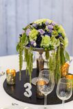 Elegant violet, green and white table setting royalty free stock images