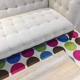 Elegant vit soffa på en ljus filt arkivbild