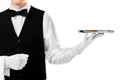Elegant waiter holding empty silver tray. On hand isolated on white background royalty free stock image