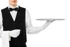 Elegant waiter holding empty silver tray. On hand isolated on white background stock images
