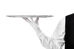 Elegant waiter holding empty silver tray Stock Photo