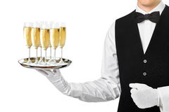 Elegant waiter serving champagne on tray royalty free stock photo