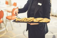 Elegant waitress serving fresh biscuits stock photos