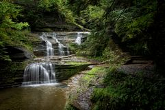 Elegant Walkway. Located in Ithaca NY, this stunning trail takes you through Buttermilk Falls Park. There are several styles of waterfalls which are breathtaking royalty free stock photography
