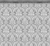 Elegant Wall of Gray Damask Wallpaper With Ornate Molding royalty free stock image