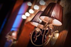 Elegant wall lamp. Elegant vintage wall lamp on a wall Royalty Free Stock Photo