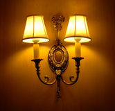 Elegant wall lamp. On wooden wall royalty free stock photography