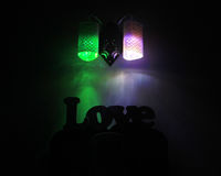 Elegant wall lamp. Colorful light with dark object stock photography