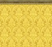 Elegant Wall of Yellow Damask Wallpaper With Ornate Molding stock image