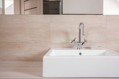 Elegant washabsin with simple tap Stock Photo