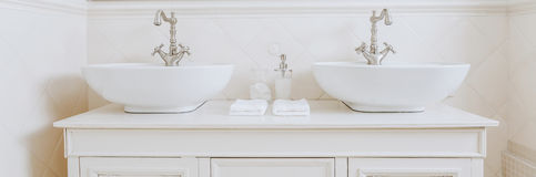 Elegant washbasins in white bathroom Stock Image