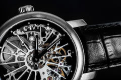 Elegant watch with visible mechanism, clockwork. Time, fashion, luxury concept. Stock Photos