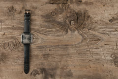 Elegant watches lying on a wooden surface Royalty Free Stock Photo