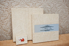Elegant wedding album and photo book from beige material. Royalty Free Stock Photos