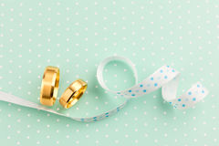 Elegant Wedding background - Two Wedding rings with ribbon Stock Photo