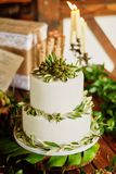 Elegant wedding cake with flowers and decor from green berries. Vegetarian sweets royalty free stock photo