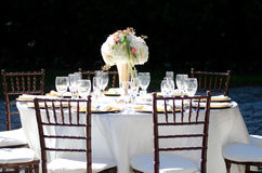 Elegant Wedding at Deering Estate Table Setting. Elegant Wedding Table Setting at the Deering Estate in Miami Florida with flower arrangement Royalty Free Stock Images