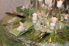 Elegant wedding dinner. Served on a glass table Stock Image