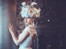 Elegant wedding dress and crown. Gorgeous woman. Tender bride in Royalty Free Stock Image