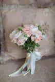 Elegant wedding flower bridal bouqet on texture sofa. Background stock photo