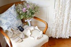 Elegant wedding flowers and bride's accessories Stock Photos