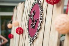 Elegant wedding reception decoration: bride & groom initials on Stock Photos