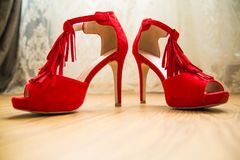 Elegant wedding red bridal shoes for celebration. Royalty Free Stock Images