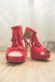 Elegant wedding red bridal shoes for celebration. Stock Photography
