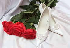 Elegant wedding shoes with red roses Stock Photo