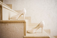 Elegant wedding shoes. On stairs Stock Photography